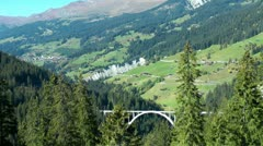 Alpine train on Langwies Viaduct, Swiss Alps, Switzerland Stock Footage