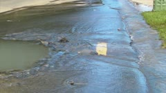 Broken street water main wasted water b Stock Footage