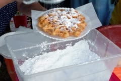 Making a funnel cake at the fair - stock footage