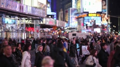Crowd Walking Intersection crossing street at night new york times square Stock Footage