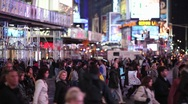 Stock Video Footage of Crowd Walking Intersection crossing street at night new york times square