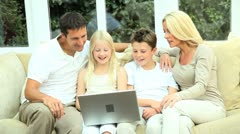 Young Family Using Laptop for Webchat Stock Footage