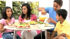 Young Ethnic Family Eating Healthy Lunch Together - stock footage