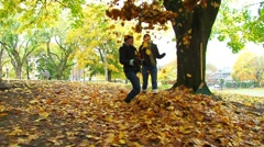 Friends Playing in Leaves 3 Stock Footage