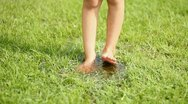 Bare feet in green grass Stock Footage