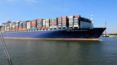 Cargo barge headed out to sea from American port Stock Footage
