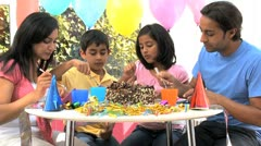 Young Ethnic Family Enjoying Birthday Cake Stock Footage