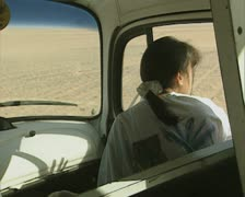 Interior of driving truck with woman in front seat Stock Footage