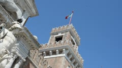 Venice tower with flag and pigeon Stock Footage