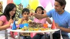 Asian Family Enjoying Delicious Birthday Cake Stock Footage