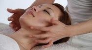 A girl having facial massage Stock Footage