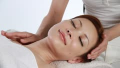 A girl having massage on her neck Stock Footage