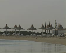 Empty sun loungers on empty beach Stock Footage