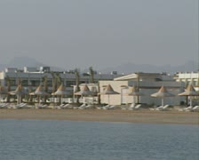 Pan across of river side and resort Stock Footage