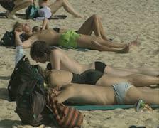 People sunbathing on beach Stock Footage