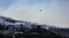 Fire fighting airplane in action Stock Footage
