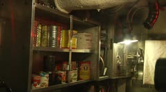 Cans of food in WWII submarine Stock Footage