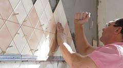 Man applying ceramic tile Stock Footage
