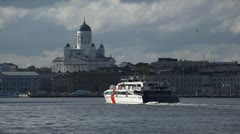 Stock Video Footage of Cruise Boat passing, Helsinki Skyline, Cathedral, Finland, Harbor, Trip, Tour