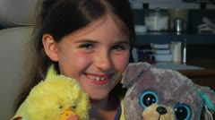 Little girl with stuffed animals at dentist Stock Footage