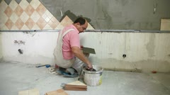 Worker installing Tiles Stock Footage