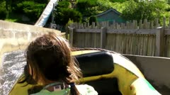 Little girl on water ride Stock Footage