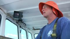 Lobsterman operating lobster boat Stock Footage