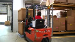 Fork lift sets down large boxes Stock Footage