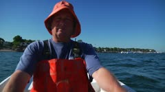 Lobsterman rowing to Lobster Boat Stock Footage