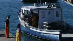 Crew boarding lobster boat Stock Footage