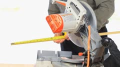 Man Using Power Miter Saw Stock Footage