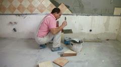 Putting mortar on Tiles Stock Footage