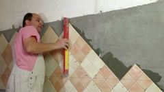 Installing Tiles - checking level Stock Footage