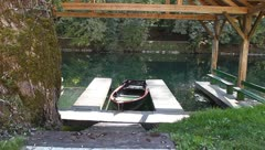 Boathouse, small boat tied - stock footage
