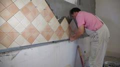 Installing Ceramic Tile Stock Footage