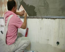 Man Tiling A Wall Stock Footage