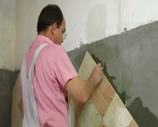 Tile Worker Wipes Grout Stock Footage