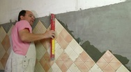 Stock Video Footage of Installing Tiles - checking level