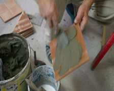 Putting mortar on Tile using  trowel Stock Footage