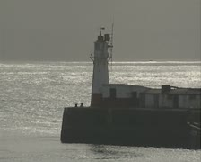 Lighthouse at end of pier - stock footage
