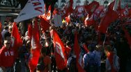 Stock Video Footage of Large crowd with communist flags at Rome demo