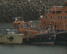 Moored lifeboats in harbour - stock footage