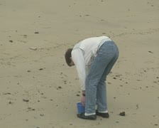 Little boy and father playing on beach Stock Footage