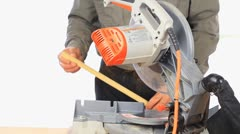 Man Using A Chop Mitre Saw For Cutting Trim - stock footage