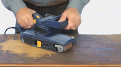 Man Using A Power Sander To Renovate A Board - stock footage
