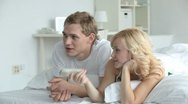 Couple watching TV Stock Footage