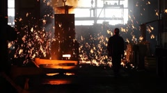 Putting iron in the furnace to melt Stock Footage