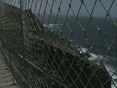 View through bridge of sea and coast Stock Footage