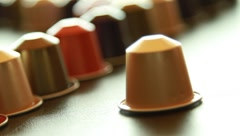 One coffee capsule coming into frame Stock Footage