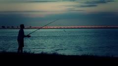 Man Fishing From Shore Silhouette Stock Footage